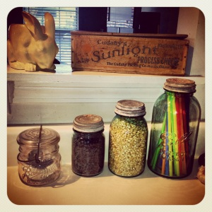 Old jars hold my cupcake papers, black beans, popcorn (no microwave corn for me, please), and straws.