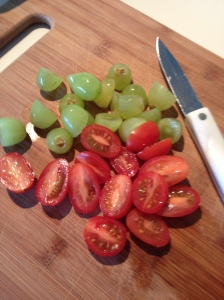 Slice the grapes and maters.