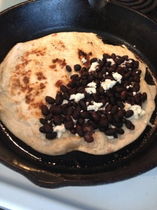Tortilla, goat cheese, black beans.